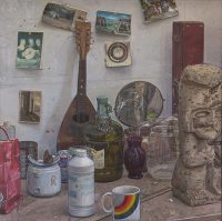 "Studio Still Life 2 (oil on canvas, 25"" x 25"", 1995) Manny Cosentino, Paintings. Still life of various objects and brick a brack on a counter in the artist's studio. Items include an old mandolin, old postcards, a broken teapot, a dried butterfly, a bottle of olive oil and an Aztec sculpture."