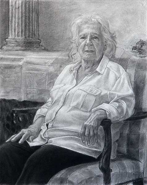 "Mom, Portrait Sketch (charcoal on paper, 21"" X 17 1/4"", 2020) © Manny Cosentino. Black and white charcoal portrait of the artist's mother. She sits in an arm chair with a checkered pattern. Her right arm rests on her right thigh, while her left arm rests on the arm of the chair, with her left hand coming forward in the space. In the background is a piece of furniture covered with a cloth. On top of the furniture on the right edge of the composition is a plate of pomegranates. In the background to the left, behind the furniture, one sees a column."